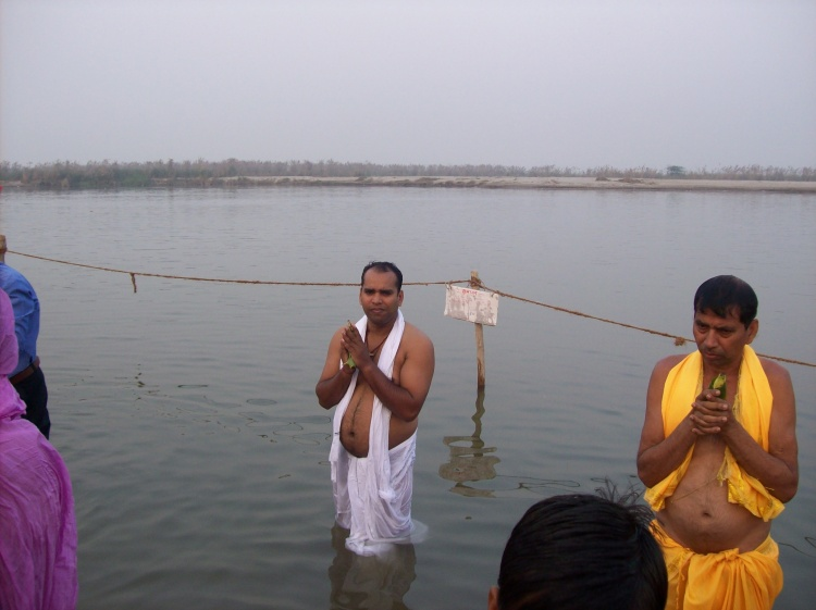 A bhakta standing amidst water