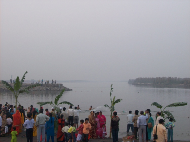 Devotees waiting on the banks of River Yamuna for the sun to rise
